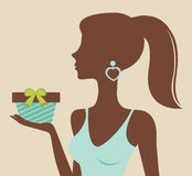 Young beautiful woman holding gift box Stock Image