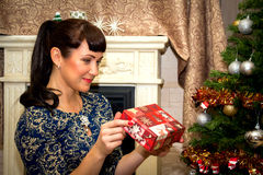 Young beautiful woman holding gift box. Royalty Free Stock Images