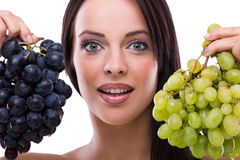 Young beautiful woman holding grapes Royalty Free Stock Image