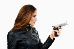 Young beautiful woman holding a gun on white background Royalty Free Stock Images