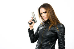 Young beautiful woman holding a gun on white background Stock Photos