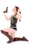 Young beautiful Woman holding Handgun Stock Photography