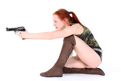Young beautiful Woman holding Handgun Stock Photo