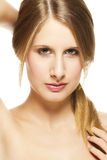 Young beautiful woman holding her pigtail Stock Photography