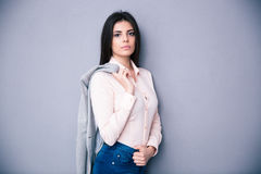 Young beautiful woman holding jacket on a shoulder Stock Photo