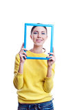 Young beautiful woman holding light blue frame Stock Images