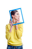 Young beautiful woman holding light blue frame Stock Photos