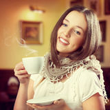 Young beautiful woman holding a mug Royalty Free Stock Photography