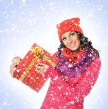 A young and beautiful woman holding a nice Christmas present Royalty Free Stock Image