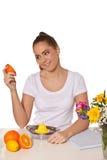 Young beautiful woman holding an orange Stock Photo
