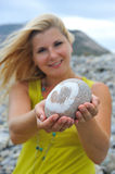 Young beautiful woman holding pebble stone Royalty Free Stock Images