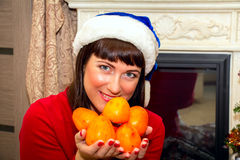 Young beautiful woman holding persimmon. royalty free stock photos