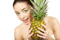 Young beautiful woman holding pineapple Stock Images
