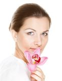 Young beautiful woman holding pink flower Royalty Free Stock Images