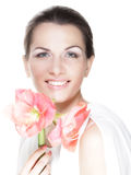 Young beautiful woman holding pink flower. Stock Photos