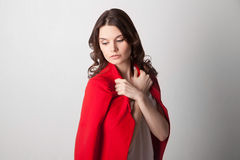 Young beautiful woman holding red jacket Royalty Free Stock Photography