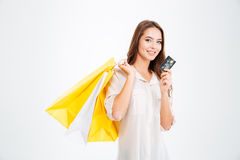 Young beautiful woman holding shopping bags and a credit card stock photography