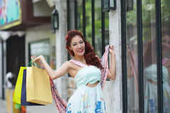 Young beautiful woman holding shopping bags Stock Photography