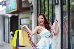 Young beautiful woman holding shopping bags Stock Photo