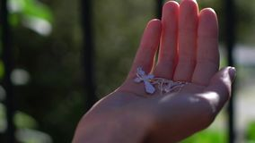 Young beautiful woman holding silver cross in hands. Christianity religion. God in hands stock video footage