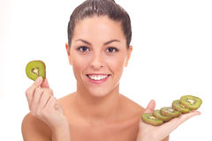 Young beautiful woman holding a slice of kiwi Stock Images