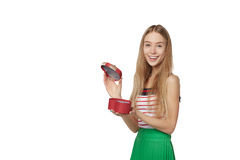 Young beautiful woman holding small red box. Studio portrait iso. Lated over white background Stock Image