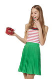 Young beautiful woman holding small red box. Studio portrait iso. Lated over white background Stock Photos