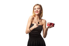 Young beautiful woman holding small red box. Studio portrait iso. Lated over white background Royalty Free Stock Photography