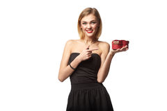 Young beautiful woman holding small red box. Studio portrait iso. Lated over white background Royalty Free Stock Photo
