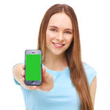 Young beautiful woman holding smartphone with copyspace. Isolated on white background Royalty Free Stock Photos