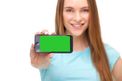 Young beautiful woman holding smartphone with copyspace Royalty Free Stock Photography
