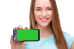 Young beautiful woman holding smartphone with copyspace Stock Photo