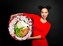 Young beautiful woman holding sushi Royalty Free Stock Photos