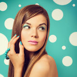 Young beautiful woman holding a turquoise bracelet with bright c Stock Images