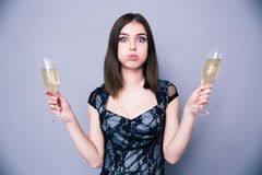 Young beautiful woman holding two glass with champagne Stock Images