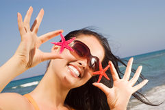 Young beautiful woman holding two starfish Stock Images
