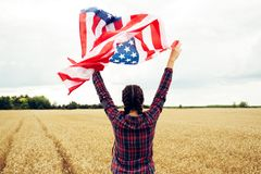 Young beautiful woman holding USA flag Stock Images