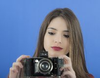 Young beautiful  woman holding a vintage photo camera Stock Photography