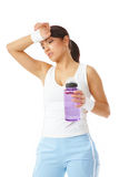Young beautiful woman holding a water bottle Stock Photo