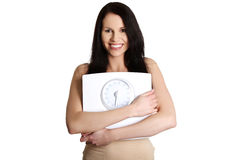 Young beautiful woman is holding weight. Royalty Free Stock Photos