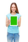 Young beautiful woman holding white tablet with copyspace Royalty Free Stock Image