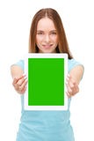 Young beautiful woman holding white tablet with copyspace Stock Image