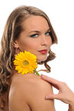Young Beautiful woman holding a yellow flower Royalty Free Stock Photo