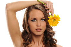 Young Beautiful woman holding a yellow flower Stock Photography
