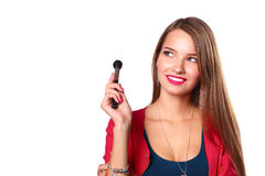 Young beautiful woman holds in hand brush for makeup Royalty Free Stock Photography