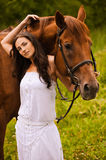 Young beautiful woman with horse Stock Image