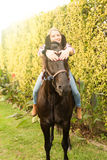 Young beautiful woman with a horse Stock Photos