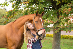 Young beautiful woman with a horse Royalty Free Stock Photos