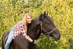 Young beautiful woman with a horse Stock Photo