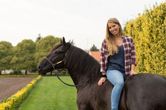 Young beautiful woman with a horse Royalty Free Stock Image